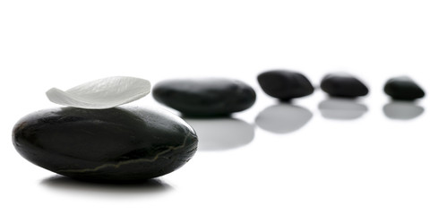 Black spa stones in a row