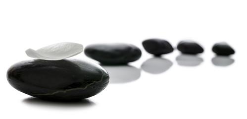 Black spa stones in a row