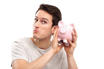 Man checking his piggy bank