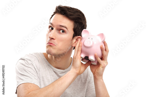Man checking his piggy bank