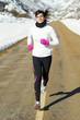 Winter running woman road
