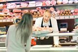 Shopkeeper serving a costumer
