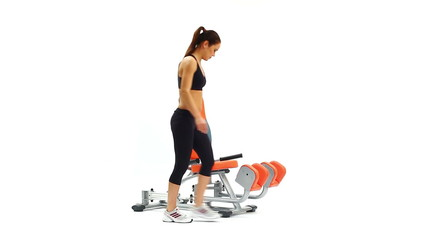 Young woman on isodynamic exerciser