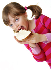 little girl eating a bread with cheese
