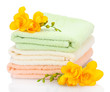 colorful towels and flowers isolated on white