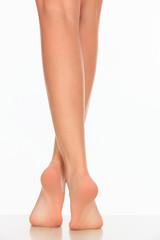 pretty woman legs on white background