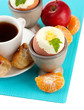 Light breakfast with boiled eggs and cup of coffee, isolated