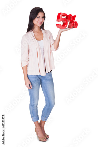 Beautiful woman holding 5% sale sign