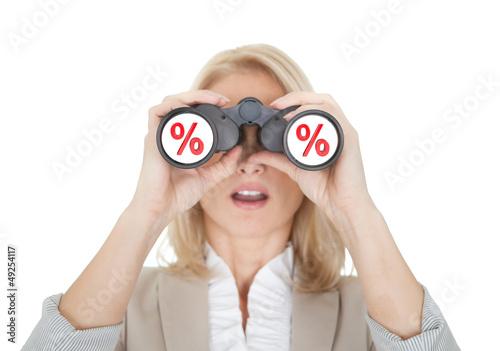 Women looking for sale through binoculars