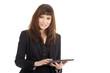 Junge Geschäftsfrau mit PC Tablet lächelt freundlich