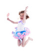 Happy little girl with lollipop jumping