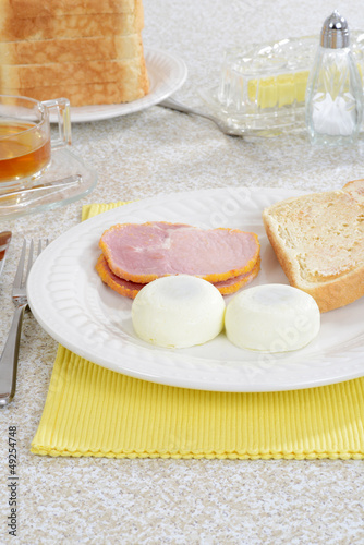 Poached eggs with Peameal bacon