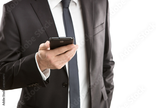 Close up of young businessman using smart phone