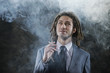 Businessman smoking a joint