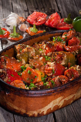 Baked tomato and peppers