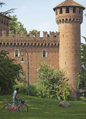 Caucasian couple looking at Italian tower