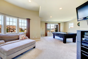 Large family room with pool table and tv.