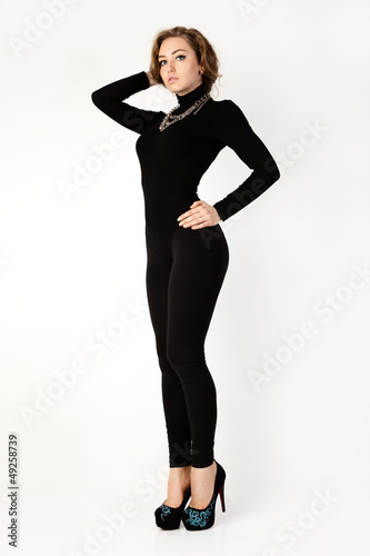 Woman in a black suit. Isolation on a white background .