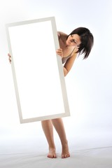 Girl holding a blank billboard isolated white background