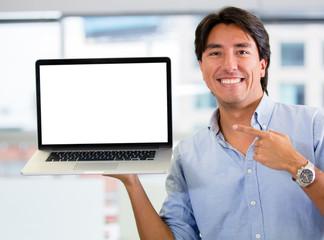 Businessman holding a computer