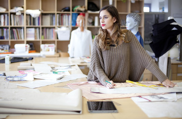 Fashion designer daydreaming in the studio