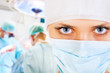 Close-up of a female surgeon with his team