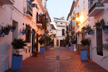 Street in spanish town Estepona at dusk, Andalusia, Spain