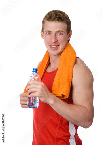Young athletic man holding a bottle. isolated on white
