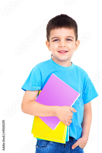 little boy with notebooks