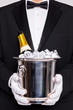 Waiter with Champagne in a silver cooler