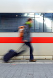 A Motion Blurred Student Rushing To Catch A Train