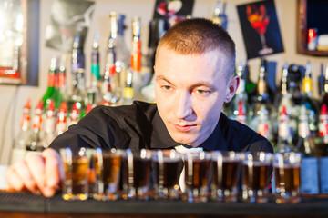 barman making  drink shots