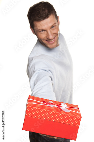 Handsome Man Offering A Present On White Background
