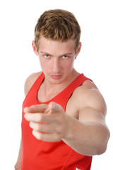 smiling athletic man pointing his finger at you. isolated