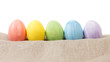 easter eggs on burlap in a row