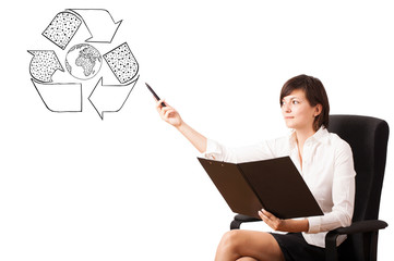 Young woman presenting recycle globe on whiteboard