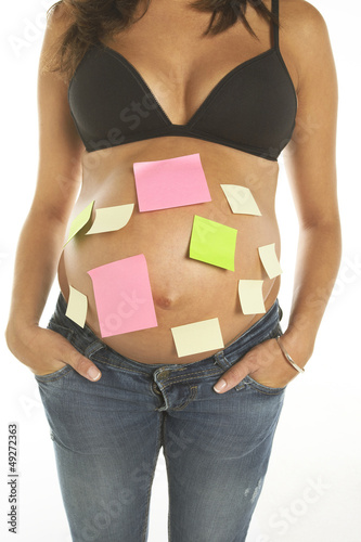 Pregnant woman with post its in her belly
