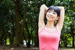 attractive asian woman stretching in the park