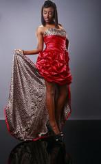 Cute brunette in red dress
