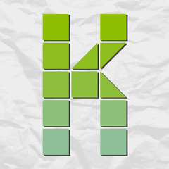 Letter K from squares and triangles on a paper-background. Vecto