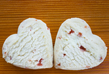 Heart shaped shortcake biscuits with strawberry filling.
