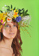 Spring-woman in wreath of flowers