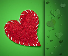 red heart on green background