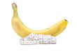 Banana and measuring tape on a white background