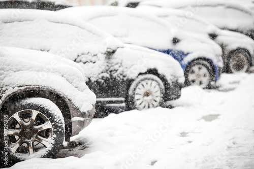 Cars covered with white snow