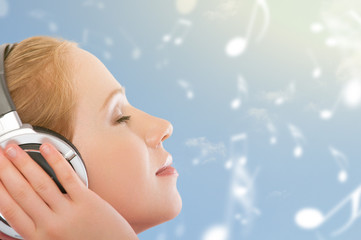 musical concept. woman  enjoy the music on the sky background wi