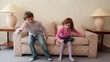Two kids boy with girl come in room, sit and jump on sofa