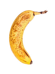 Ripe, spotted banana isolated against a white background