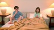 Two kids boy with girl in lay on bed and drink water before