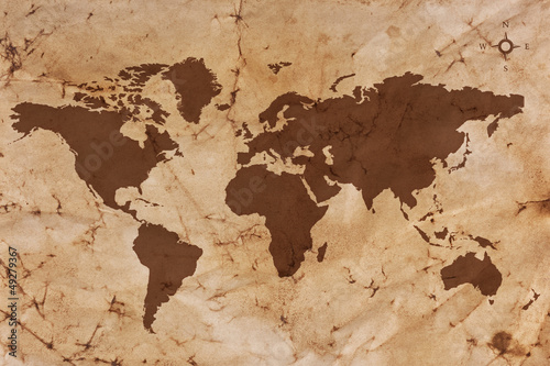 Poster Wereldkaart Old World map on creased and stained parchment paper